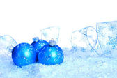 Three Blue Ornaments in Faux Snow — Stock Photo