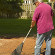 Retired man Raking — Stock Photo