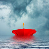 Upside down red Umbrella Floating in Storm — Stock Photo