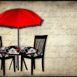 Patio with red umbrella (French Background in Writing) — Stock Photo