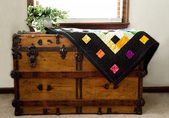 Home-made Quilt on Antique Chest — Zdjęcie stockowe