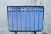 Retro mailboxes against old fence — Stock Photo