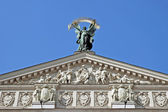 Sculpture of Glory with a palm branch on the pediment Opera in L — Stock Photo