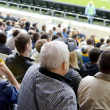 Stock Photo: Spectators in stands of football stadium