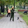 Janitors sweep sidewalks in park — Stock Photo #16260437