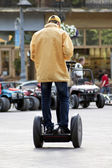 A man rides a segway scooter — Stock Photo