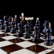 Chess, isolated over black - Stock Photo