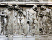 Old bas-relief mans and womens — Stock Photo