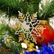 New Year background - beautiful toys on a Christmas tree — Stock Photo