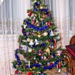 Foto Stock: New Year background - Christmas tree decorated with toys