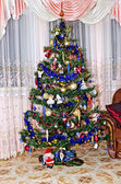 New Year background - Christmas tree decorated with toys — Stock Photo