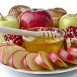 Still life - challah, apples, pomegranate and bowl of honey — Stock Photo #19681469