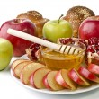 Still life - challah, apples, pomegranate and bowl of honey — Stock Photo