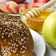 Still life closeup - challah, apples and bowl of honey — Stock Photo