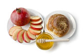 Still life - challah, apples, pomegranate and bowl of honey — Stock Photo
