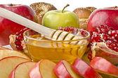 Still life closeup - challah, apples, pomegranate and bowl of ho — Stock Photo
