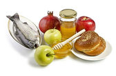 Still life with apples, pomegranates, fish, challah and honey — Stock Photo