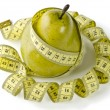 Pear and measuring tape — Stock Photo