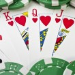 Playing cards (royal flush) and casino chips — Stock Photo