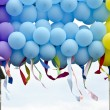 Stock Photo: Colorful balloons with developing colorful ribbons