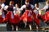 Ukrainian girls in traditional dress dancing a folk dance — Stock Photo
