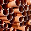 Plastic orange pipes — Stock Photo #21632629
