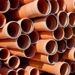 Plastic orange pipes — Stock Photo