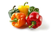 Five colorful peppers isolated over white — Stock Photo