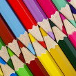 Colorful pencils closeup arranged in a row on the diagonal — Stock Photo #22247919