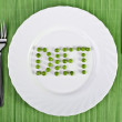 Tableware - the word diet of green peas on a white plate — Stock Photo