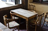 Vintage wooden table with chairs — Stock Photo