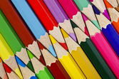 Colorful pencils closeup arranged in a row on the diagonal — Stock Photo