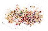 Shavings of colored pencils isolated over white — Stock Photo