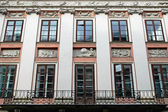 Facade of the building with bas-reliefs — Stock Photo