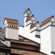 Chimneys on tiled roof — Stock Photo