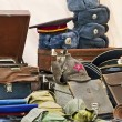 Military hats and antiques — Stock Photo