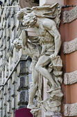 Sculpture on the facade of the house scientists in Lvov — Stock Photo