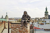 Sculpture of the chimney sweep on the roof — Stock Photo
