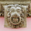 Stock Photo: Head of lion on facade