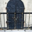 Stock Photo: Old wrought-iron door