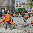 Workers laid paving stones — Stock Photo