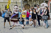 Tourists taking pictures with cartoon characters — Stock Photo