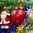 Beautiful toys on a Christmas tree - Santa Claus, heart and star — Stock Photo