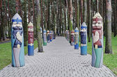 Entrance to the park with wooden sculptures of knights — Stock Photo