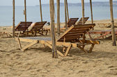 Wooden chaise lounges on a beach in the Crimea — Stock Photo