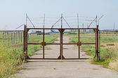 Gates at the entrance to the airfield in the Crimea — Stock Photo