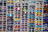 Show-window of sunglasses — Stock Photo