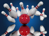 Ball crashing into bowling pins — Stock Photo