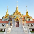 Beautiful golden pagoda Phra Mahathat Chedi Phakdi Prakat — Stock Photo