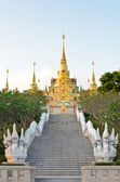 Stairs to golden pagoda Phra Mahathat Chedi Phakdi Praka — Stock Photo